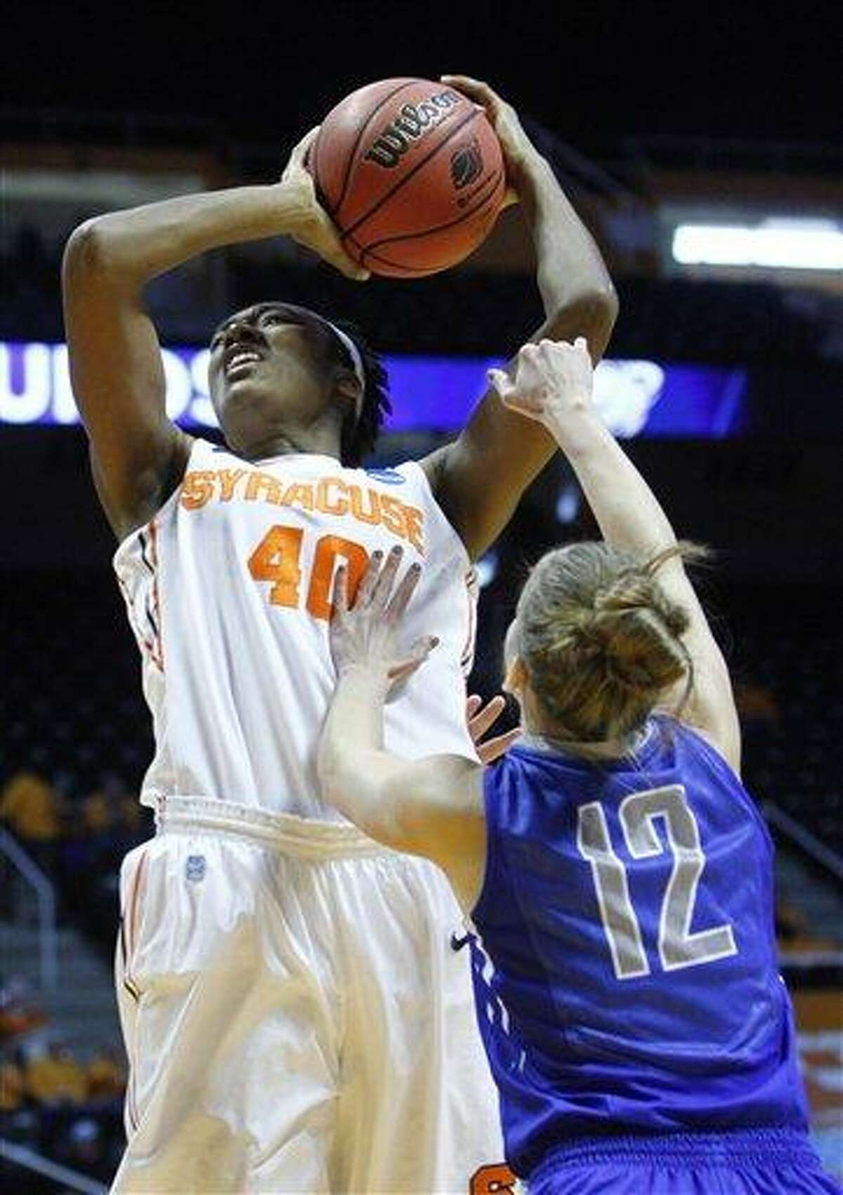 Syracuse center Kayla Alexander (40) goes for a shot as she's fouled by Creighton guard Ally Jensen (12) in the first half of a first-round game in the women's NCAA college basketball tournament on Saturday, March 23, 2013, in Knoxville, Tenn. (AP Photo/Wade Payne)