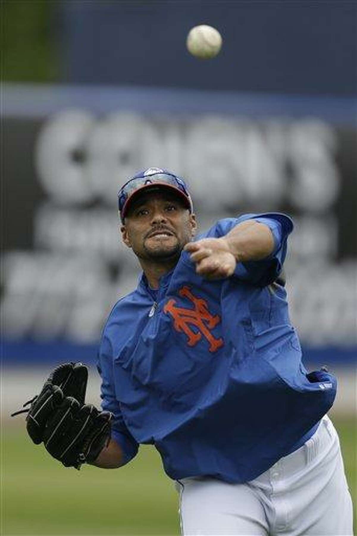 New York Mets starting pitcher Johan Santana throws while working out before an exhibition spring training baseball game Detroit Tigers, Friday, March 1, 2013, in Port St. Lucie, Fla. (AP Photo/Julio Cortez)