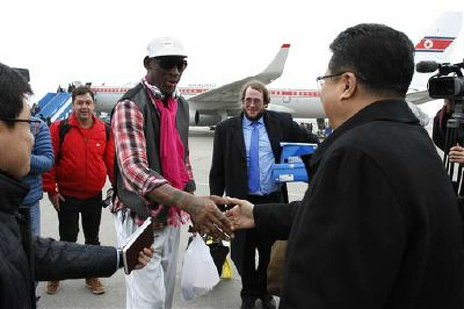 Former NBA basketball star Dennis Rodman shakes hands with North Korea's Sports Ministry Vice Minister Son Kwang Ho upon his arrival at the international airport in Pyongyang, North Korea. Photo: AP / AP