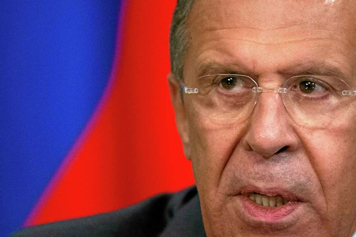 """In this photo taken on Friday, June 27, 2014, Russian Foreign Minister Sergey Lavrov speaks to the media after his talks with Fijian Foreign Minister Inoke Kubuabola in Moscow, Russia. Russia's foreign minister on Saturday accused the United States of encouraging Ukraine to challenge Moscow and heavily weighing in on the European Union. Speaking in televised remarks Saturday, Sergey Lavrov said that """"our American colleagues still prefer to push the Ukrainian leadership toward a confrontational path.(AP Photo/Alexander Zemlianichenko)"""