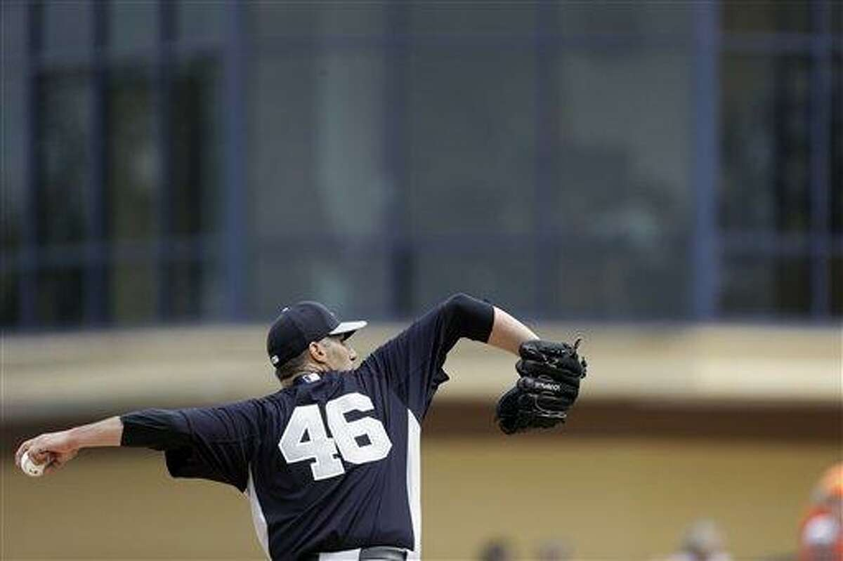 New York Yankees starting pitcher Andy Pettitte throws during an exhibition spring training baseball game against the Detroit Tigers, Saturday, March 23, 2013 in Lakeland, Fla. (AP Photo/Carlos Osorio)