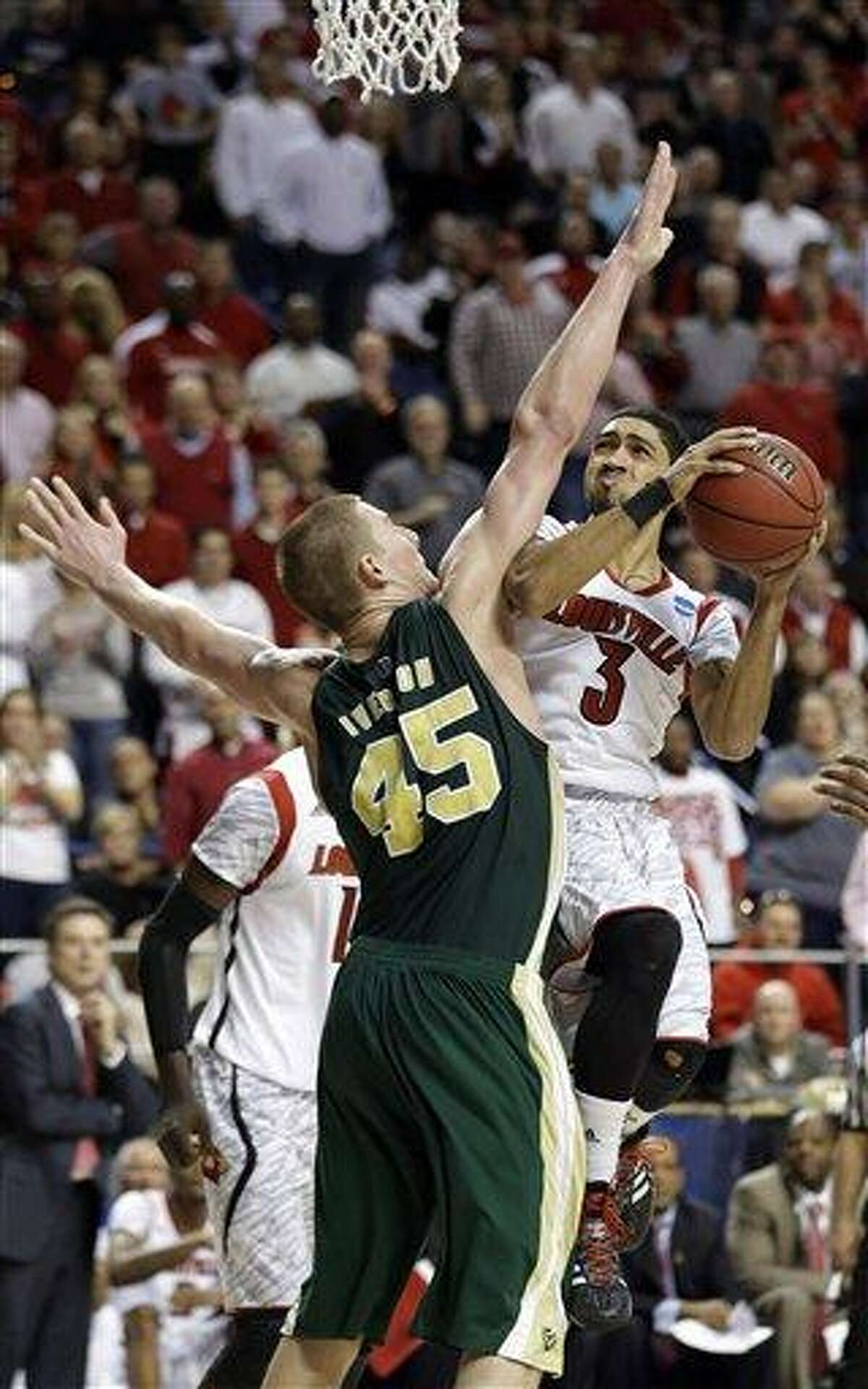 Louisville guard Peyton Siva (3) drives against Colorado State forward/center Colton Iverson (45) in the second half of a third-round NCAA college basketball tournament game Saturday, March 23, 2013, in Lexington, Ky. Louisville won 82-56. (AP Photo/John Bazemore)