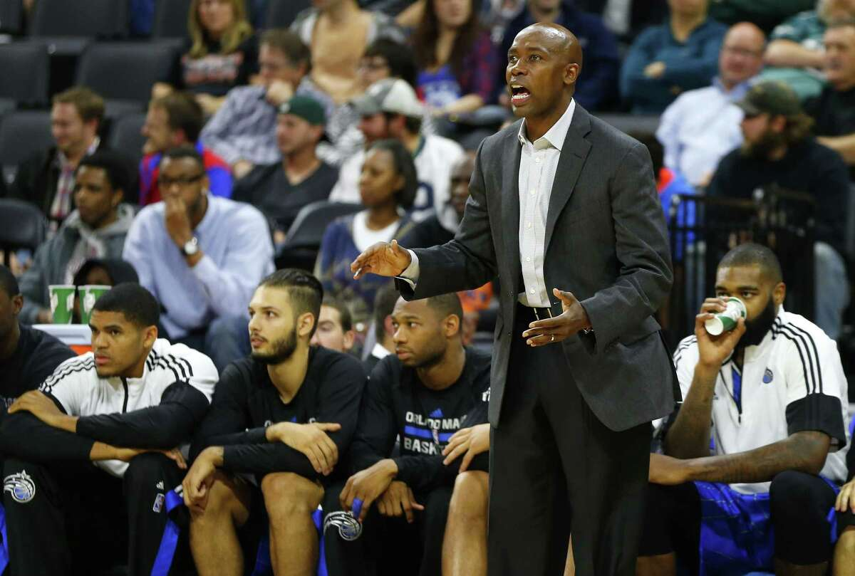 Orlando Magic coach Jacque Vaughn watches the action against the Philadelphia 76ers during a preseason game on Saturday in Allentown, Pa.