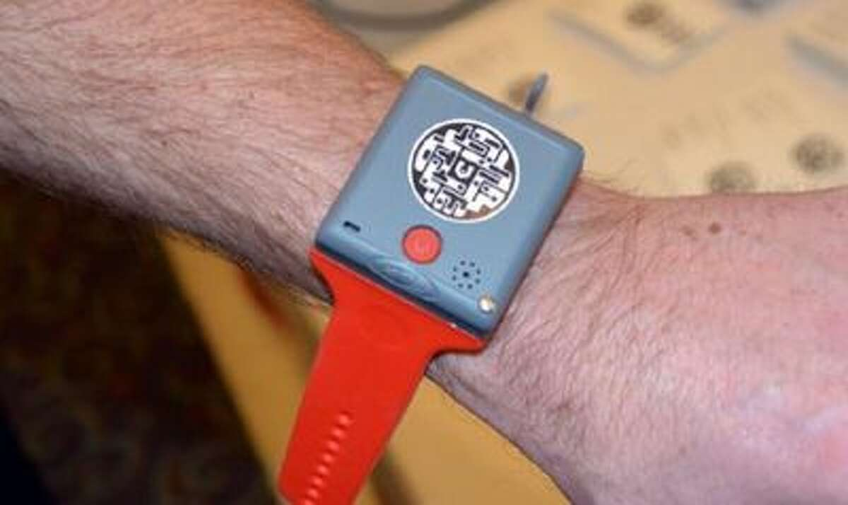 A prototype of the KMS Wristband child tracker and mobile phone on display at CES 2014 in Las Vegas.