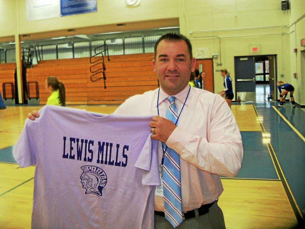 Lewis Mills Athletic Director Dave Francalangia shows off the colors for Friday's Project Purple double header between Lewis Mills and Shepaug.