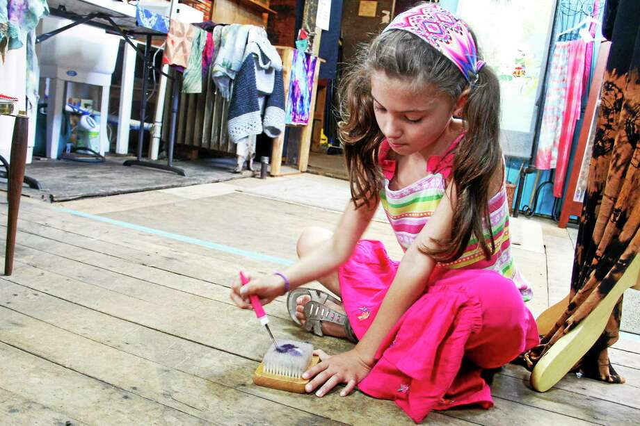 Naiya Gonzales, 8, needle felts at her grandmother Doreen Breen's studio on Saturday, June 28, 2014, in Torrington. Gonzales was visiting her grandmother for the weekend and said she started doing the activity after creating animals with the process for a school project. Esteban L. Hernandez Register Citizen Photo: Journal Register Co.