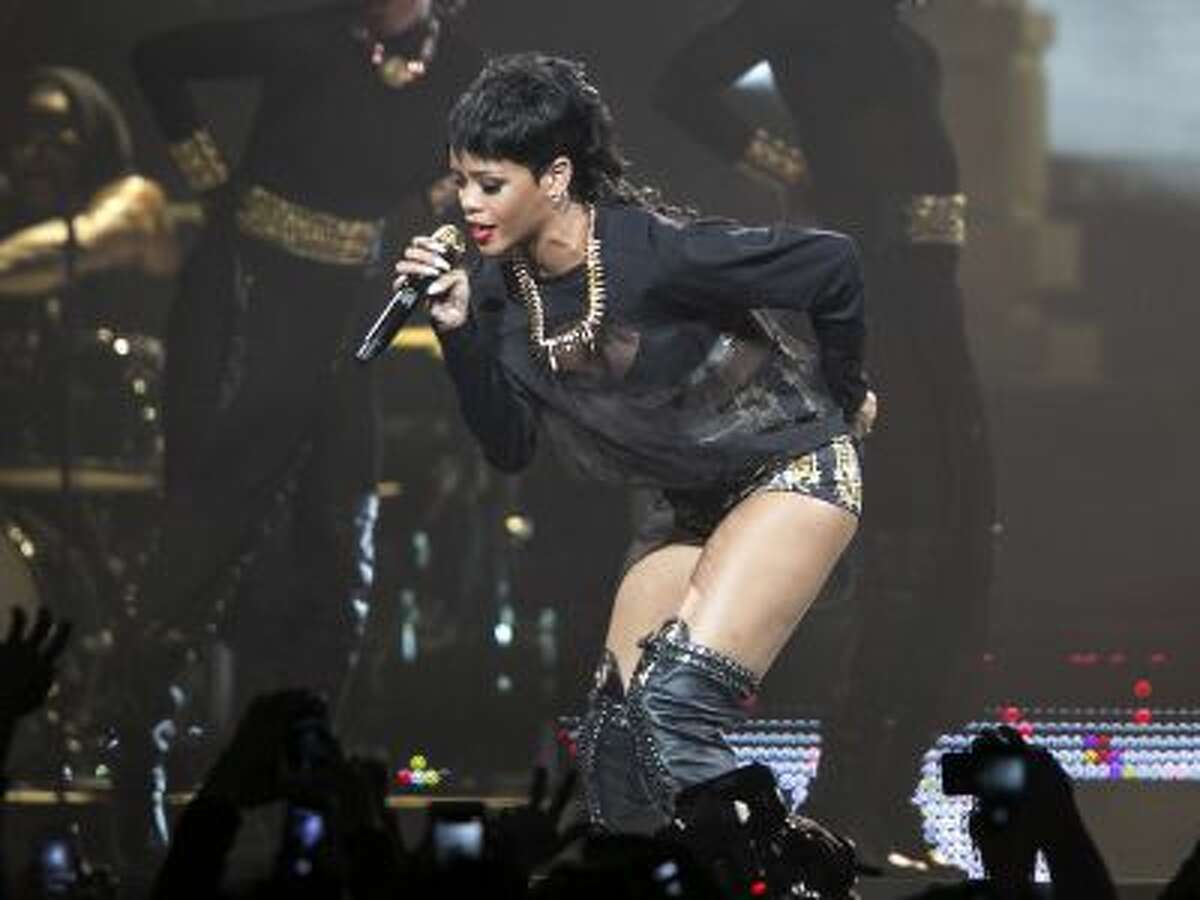 Rihanna performs in Perth, Australia during the first concert of the Australian leg of her Diamonds World Tour. (AP Photo/Lee Griffith, File)