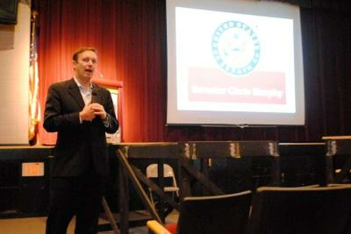 Chris Murphy (D-CT) stands in Torrington High School's Little Theater for a town hall style meeting.