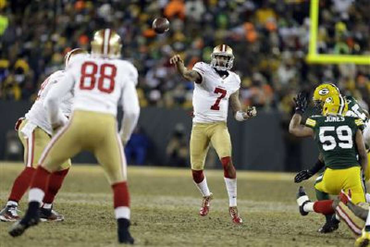 San Francisco 49ers quarterback Colin Kaepernick (7) throws a pass during the second half of an NFL wild-card playoff football game against the Green Bay Packers, Sunday, Jan. 5, 2014, in Green Bay, Wis.