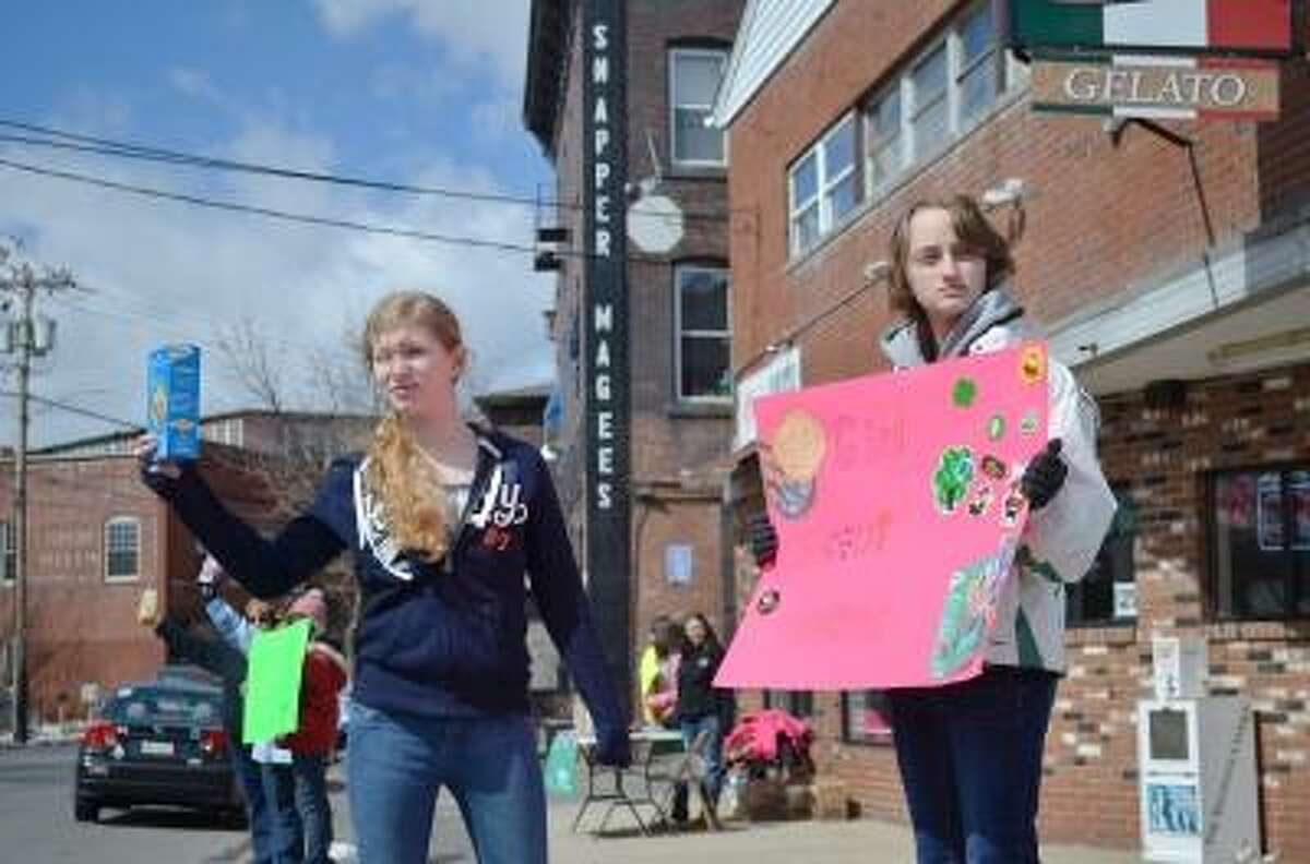 Kyra Beyer, left, and Brea Ashe, right selling cookies.