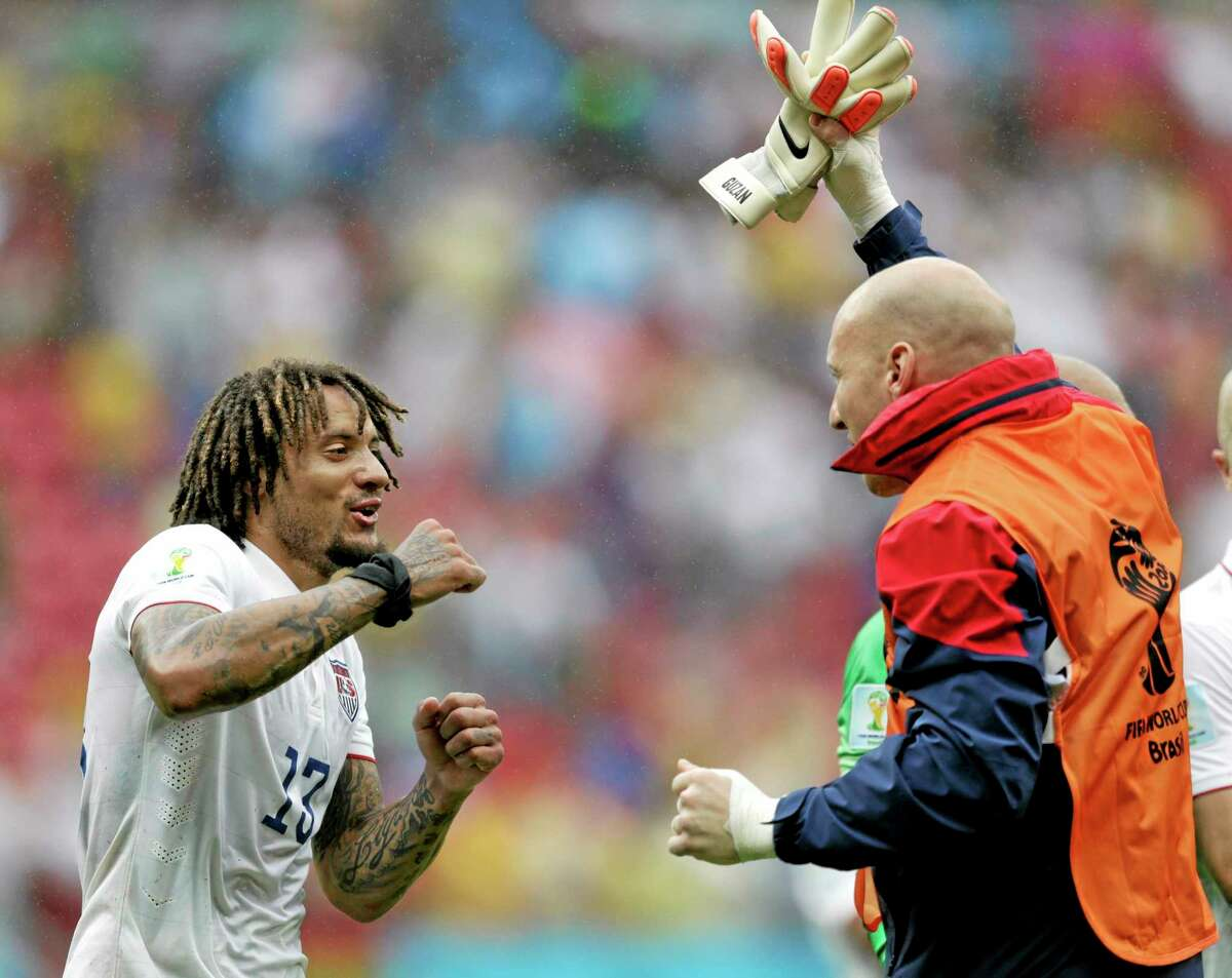 United States midfielder Jermaine Jones, left, celebrates with a teammate after qualifying for the next World Cup round despite a 1-0 loss to Germany Thursday at the Arena Pernambuco in Recife, Brazil.