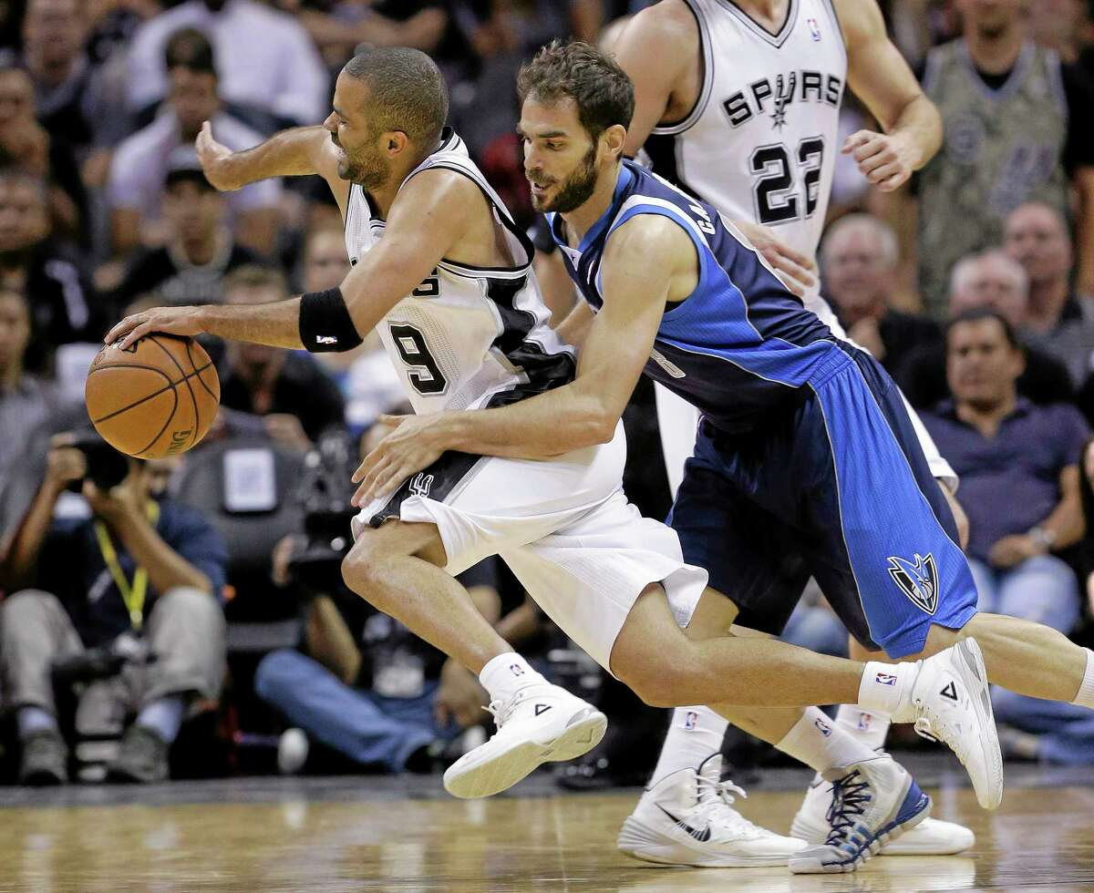 The Spurs' Tony Parker is fouled by the Dallas Mavericks' Jose Calderon during a first-round playoff game on April 30 in San Antonio.