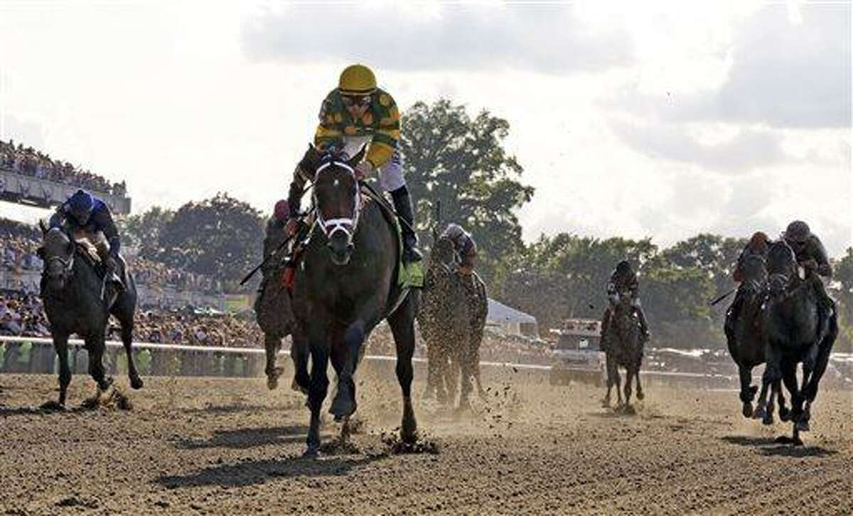 Palace Malice, center, with jockey Mike Smith, wins the 145th Belmont Stakes horse race at Belmont Park Saturday, June 8, 2013, in Elmont, N.Y. (AP Photo/Julio Cortez)