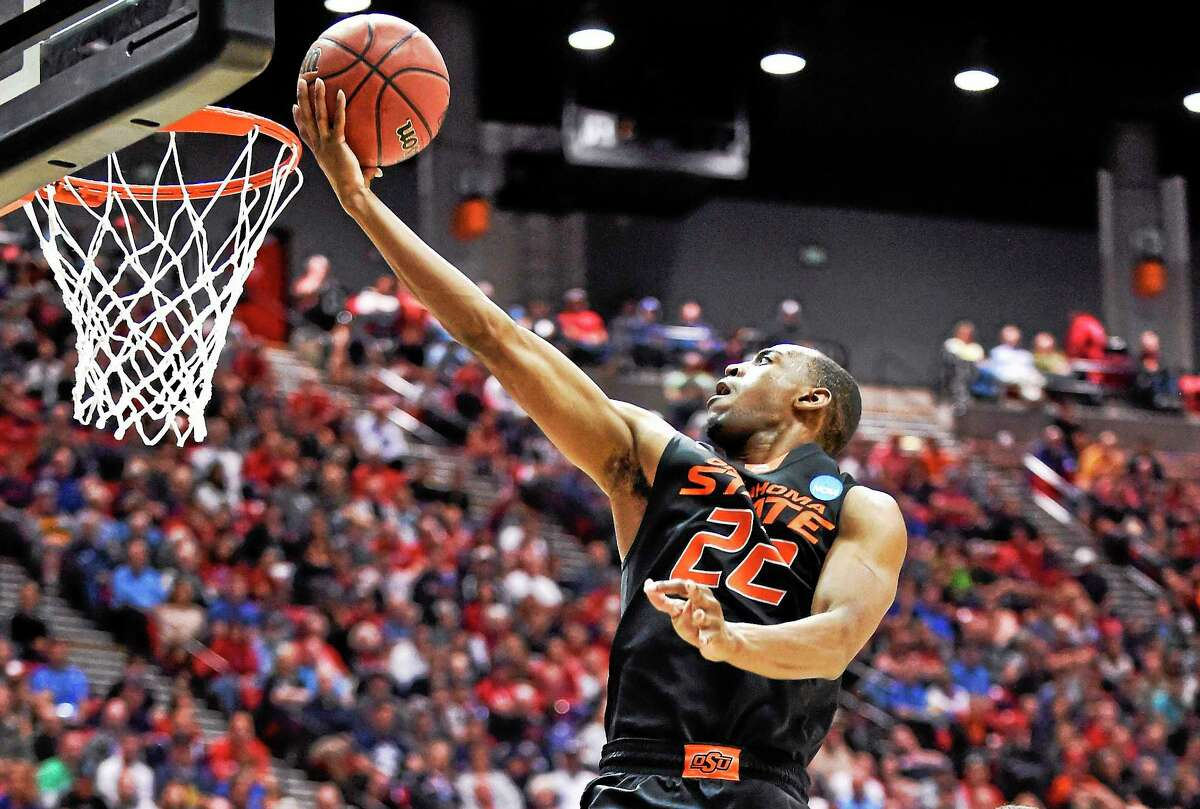 Oklahoma State guard Markel Brown sails to the basket for a score against Gonzaga during the second half of NCAA tournament second-round game on March 21 in San Diego.