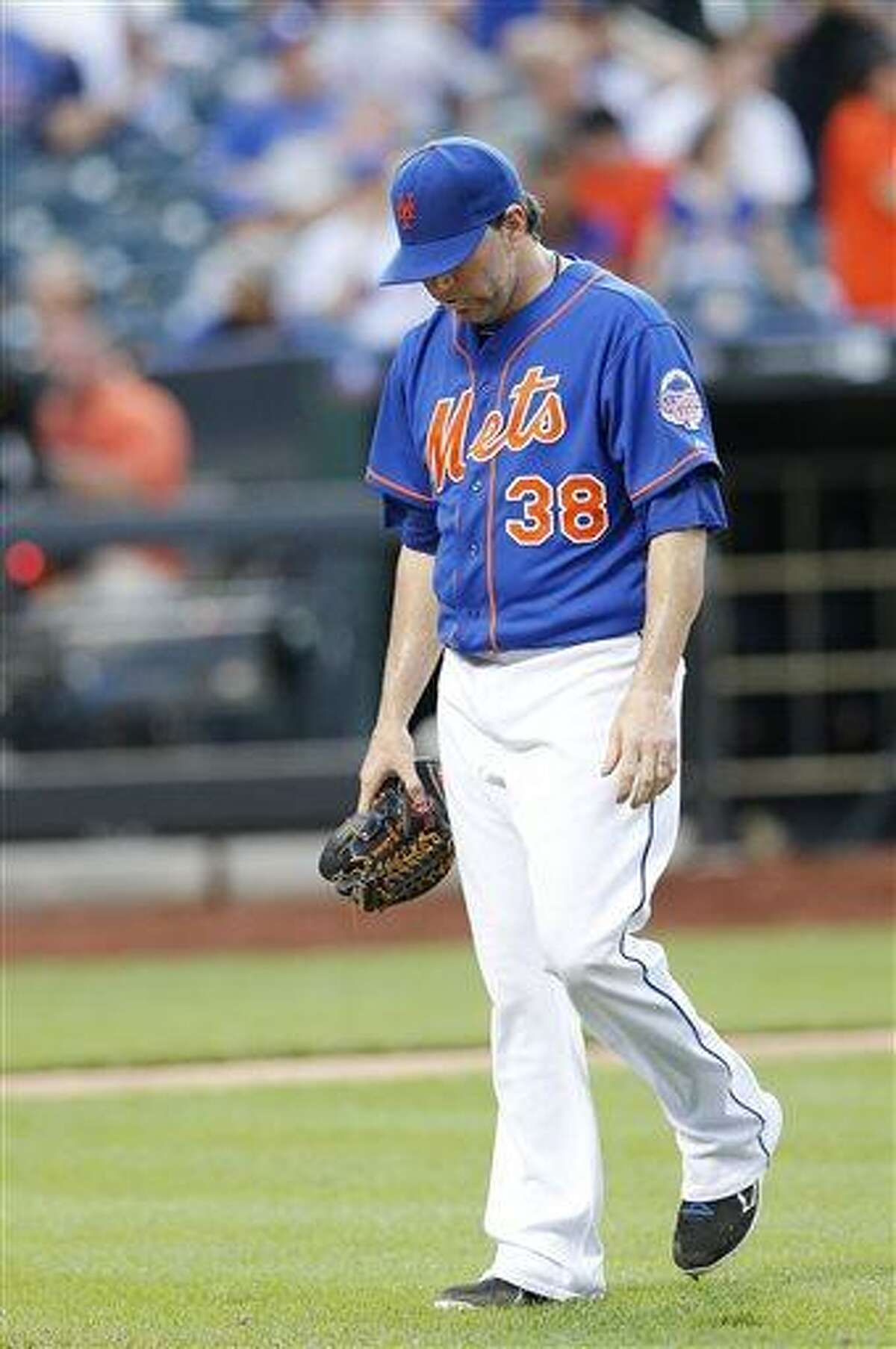 New York Mets pitcher Shaun Marcum (38) walks off the field after giving up a run in the 20th inning of 2-1 loss to the Miami Marlins during a baseball game at Citi Field in New York, Saturday, June 8, 2013. (AP Photo/Paul J. Bereswill)