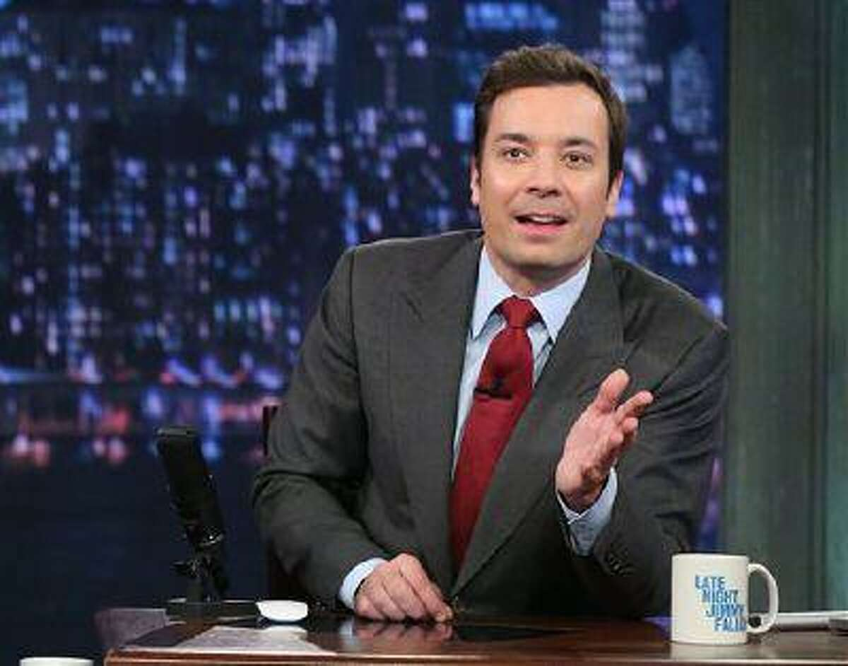 """This photo released by NBC shows Jimmy Fallon, host of """"Late Night with Jimmy Fallon,"""" on the set in New York. S speculation is swirling the network is taking steps to replace the host with Jimmy Fallonnext year and move the show from Burbank to New York. NBC confirmed March 20 it's creating a new studio for Fallon in New York, where he hosts """"Late Night."""" But the network did not comment on a report that the digs at its Rockefeller Plaza headquarters may become home to a transplanted, Fallon-hosted """"Tonight Show."""" (AP Photo/NBC, Lloyd Bishop)"""