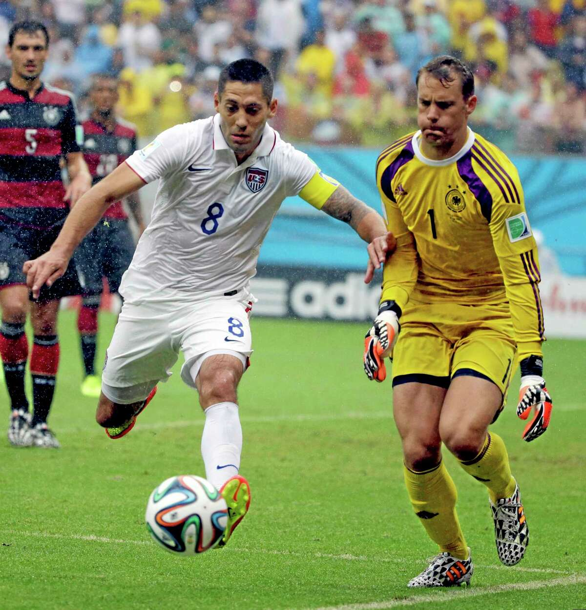 The United States' Clint Dempsey chases the ball in front of German goalkeeper Manuel Neuer during their Group G World Cup match Thursday at the Arena Pernambuco in Recife, Brazil.