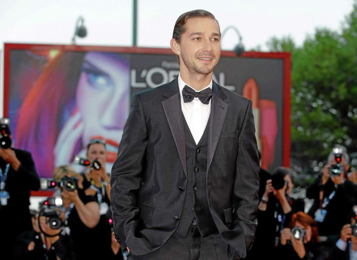"""FILE - In this Sept. 6, 2012 file photo, actor Shia LeBeouf arrives for the premiere of the movie """"The Company You Keep"""" at the 69th edition of the Venice Film Festival in Venice, Italy. The New York Police Department confirms on Thursday, June 26, 2014, that LeBeouf was taken out of a New York City theater for being disorderly and causing a disruption. (AP Photo/Andrew Medichini, file)"""
