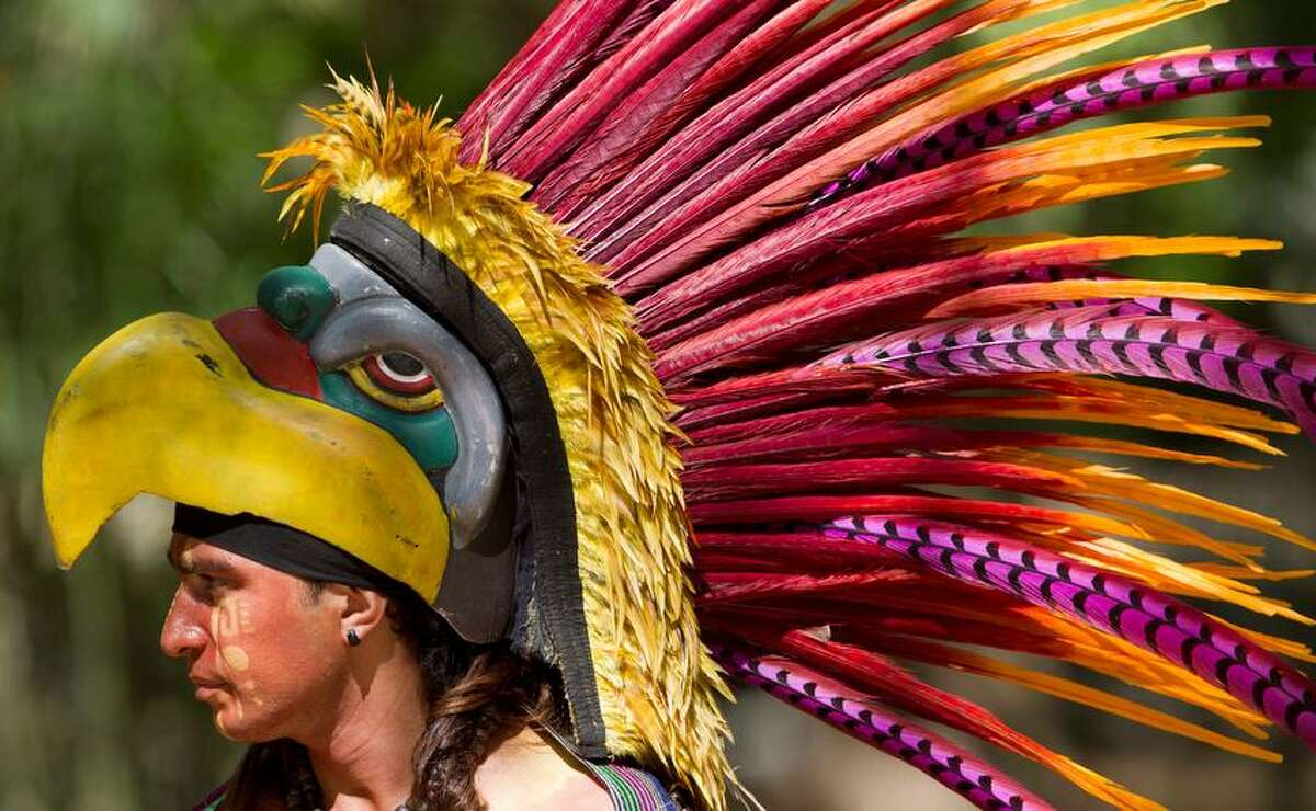 A traditional Mexican Indian dancer waits for the arrival of China's President Xi Jinping, and his wife near the Mayan ruins of Chichen Itza, southern Mexico, Thursday, June 6, 2013. The Chinese first couple toured the Mayan ruins on the final day of their 3-day visit with Mexico's President Enrique Pena Nieto and his wife. Xi said China will sign contracts to buy more than $1 billion worth of Mexican products. He also said the number of scholarships for Mexicans to study in China will be increased to 300 over the next three years from 40. (AP Photo/Eduardo Verdugo)