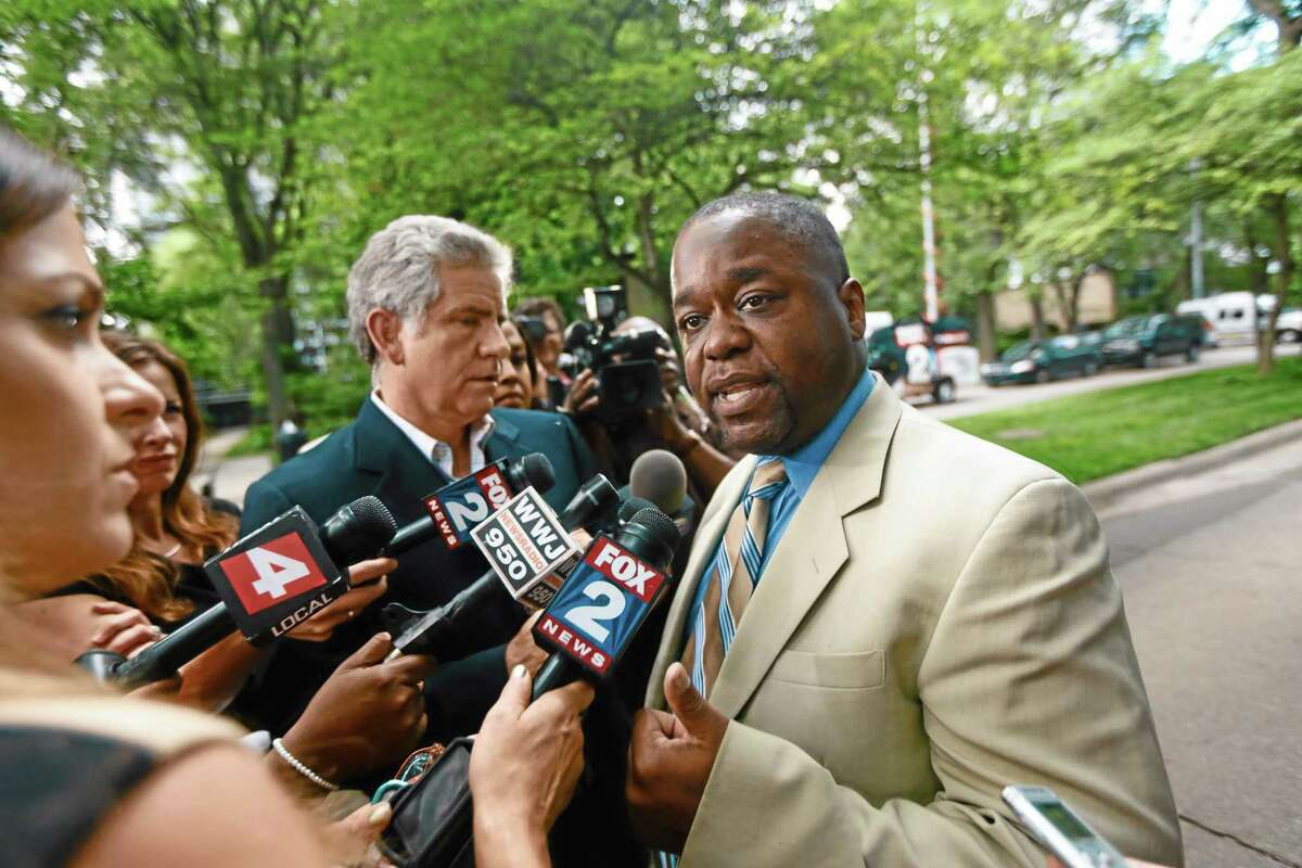 Charles Bothuell IV speaks to the media after finding out that his son Charlie Bothuell V was found alive in the basement of his home in Detroit on Wednesday, June 25, 2014. The younger Bothuell had been missing for a week and a half. (AP Photo/Detroit Free Press, Kimberly P. Mitchell)