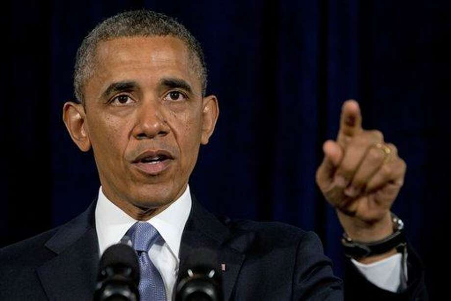 President Barack Obama gestures while speaking in San Jose, Calif. , Friday, June 7, 2013. The president defended his government's secret surveillance, saying Congress has repeatedly authorized the collection of America's phone records and U.S. internet use. (AP Photo/Evan Vucci) Photo: AP / AP