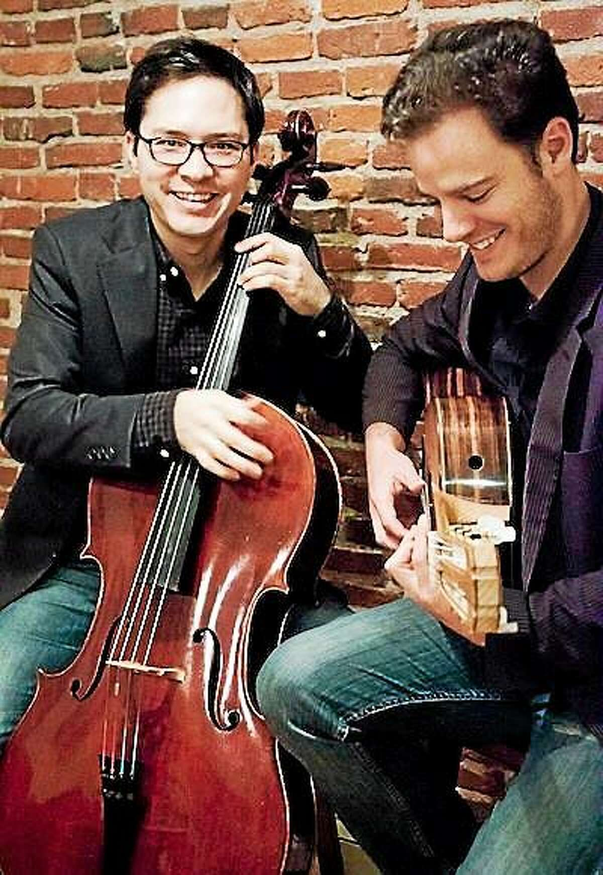 Submitted photo Australian guitarist Simon Powis and American cellist Jacques Lee Wood perform in Collinsville Nov. 9.
