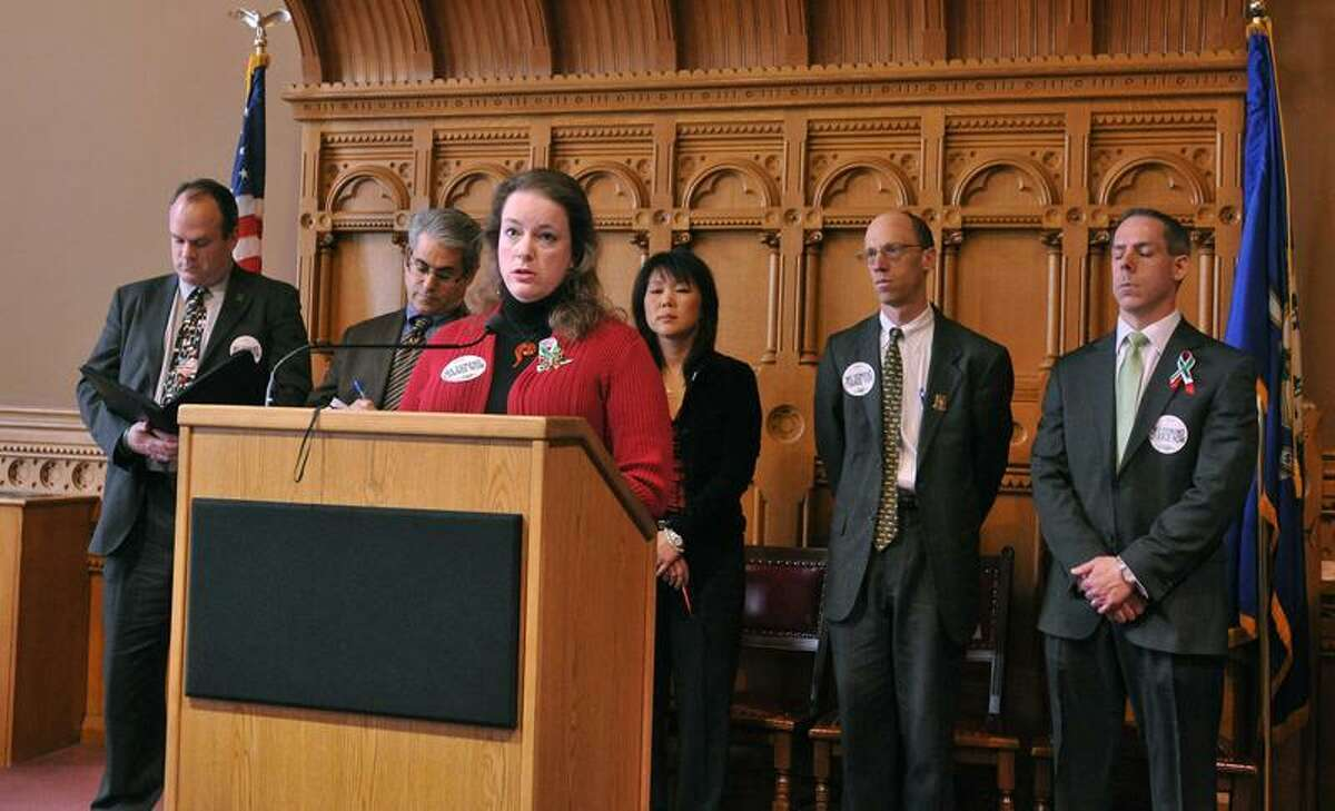 Hartford--Erin Nikitchyuk, a mother of a surviving child from Sandy Hook Elementary, speaks to the media as families deliver a letter to CT legislators and leadership asking for a vote on gun control at the state capitol. Photo-Peter Casolino/Register pcasolino@newhavenregister.com