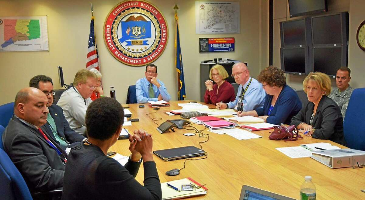 Gov. Dannel P. Malloy and other state officials are briefed by Department of Public Health Commissioner Jewel Mullen on the state's response to Ebola Oct. 15 in Hartford.