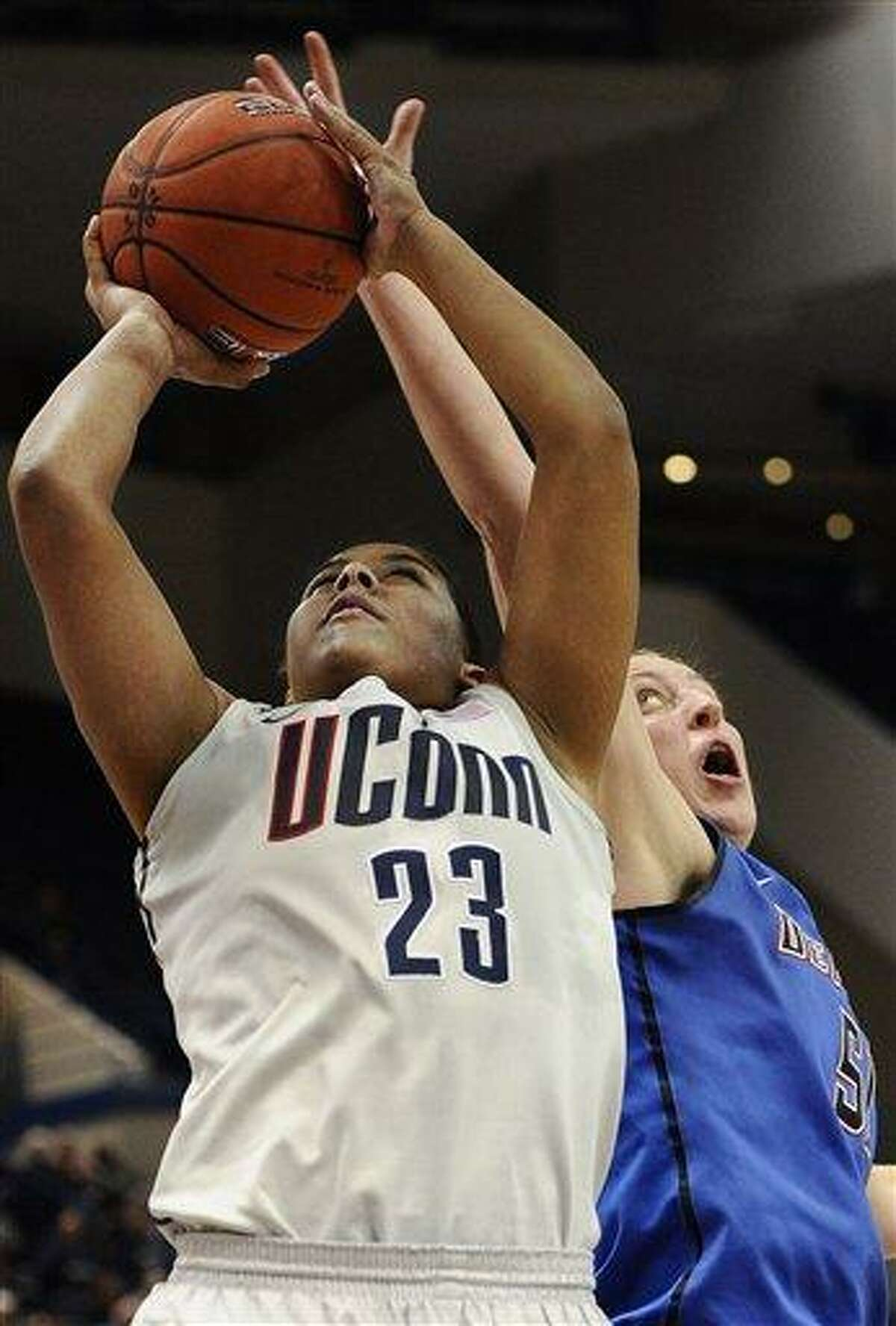 Connecticut's Kaleena Mosqueda-Lewis is guarded by DePaul's Katherine Harry, right in the second half of an NCAA college basketball game in the quarterfinals of the Big East Conference women's tournament in Hartford, Conn in Hartford, Conn., Sunday, March 10, 2013. Connecticut won 94-61. (AP Photo/Jessica Hill)