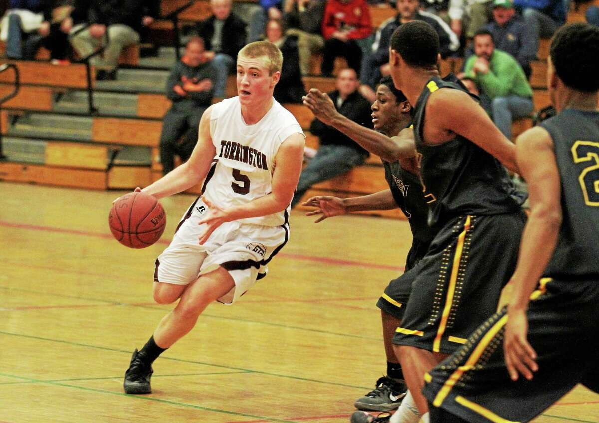 Torrington's Connor Finn looks to make a pass during the Red Raiders 86-82 overtime loss to Kennedy.