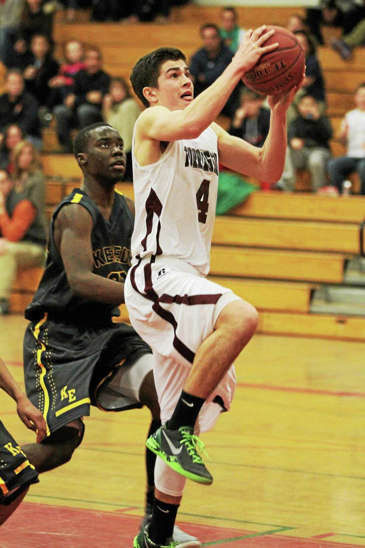 Torrington's John McCarthy lays in two of his team high 27 points in the Red Raiders 86-82 overtime loss to Kennedy.
