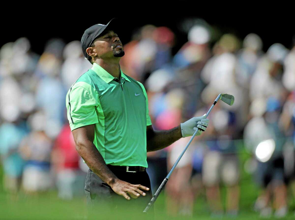 Tiger Woods reacts on the 17th fairway during the first round of the Quicken Loans National on Thursday in Bethesda, Md.