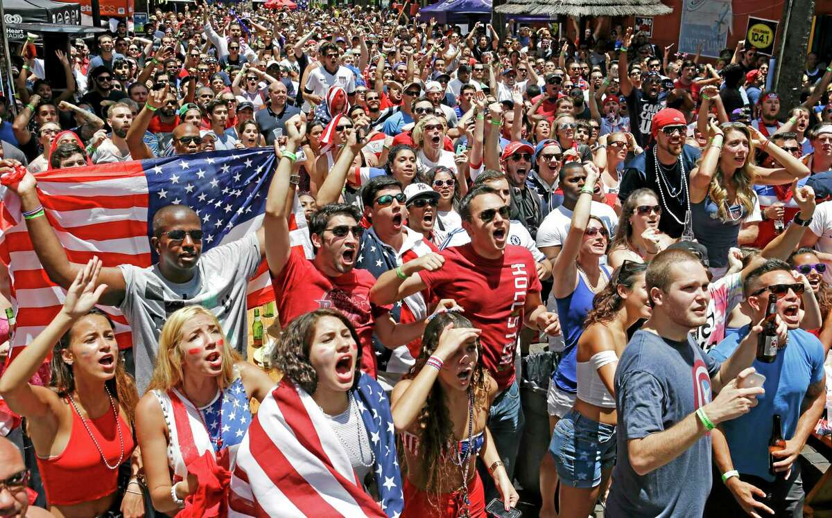 Fans react to a missed shot on goal by the United States as they watch a World Cup soccer match between the United States and Germany, Thursday, June 26, 2014, in Orlando, Fla. (AP Photo/John Raoux)