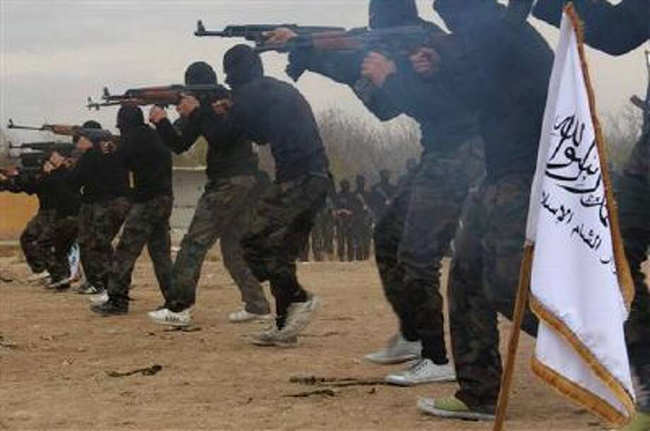 Members of Ahrar al-Sham brigade, one of the Syrian rebels groups, exercise in a training camp at an unknown place in Syria. The global terror network al-Qaida is positioning itself as a vanguard defending a persecuted Sunni community against Shiite-dominated governments across Syria, Lebanon and Iraq. For moderates around the region, the renewed assertiveness of the jihadis is increasingly taking on the aspect of a regional calamity. Photo: AP / Militant Group Via Facebook