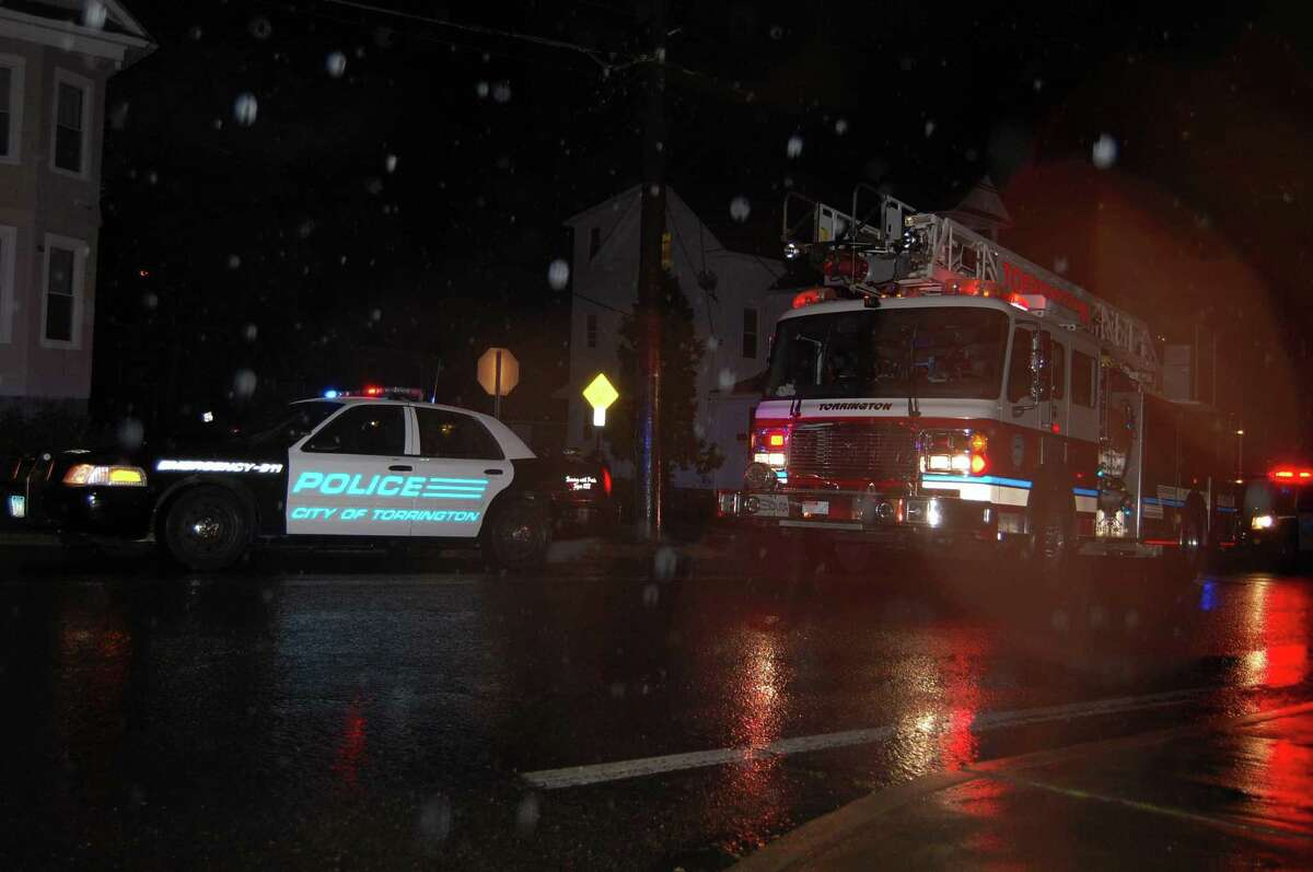 At least one person taken to hospital after car crash at the corner of Prospect & North Elm streets in Torrington Friday evening. (Tom Caprood/Register Citizen)