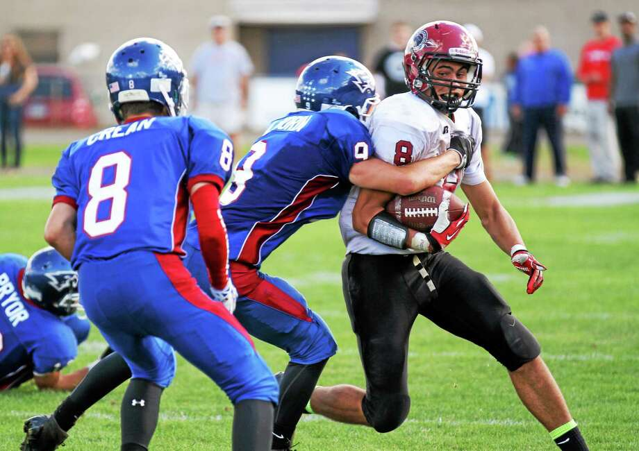 Torrington's Desmond Langs caught 61 passes for 970 yards and nine touchdowns this season and will play the Super 100 Classic all-star game this Saturday. Photo: Marianne Killackey — Special To The Register Citizen  / 2013