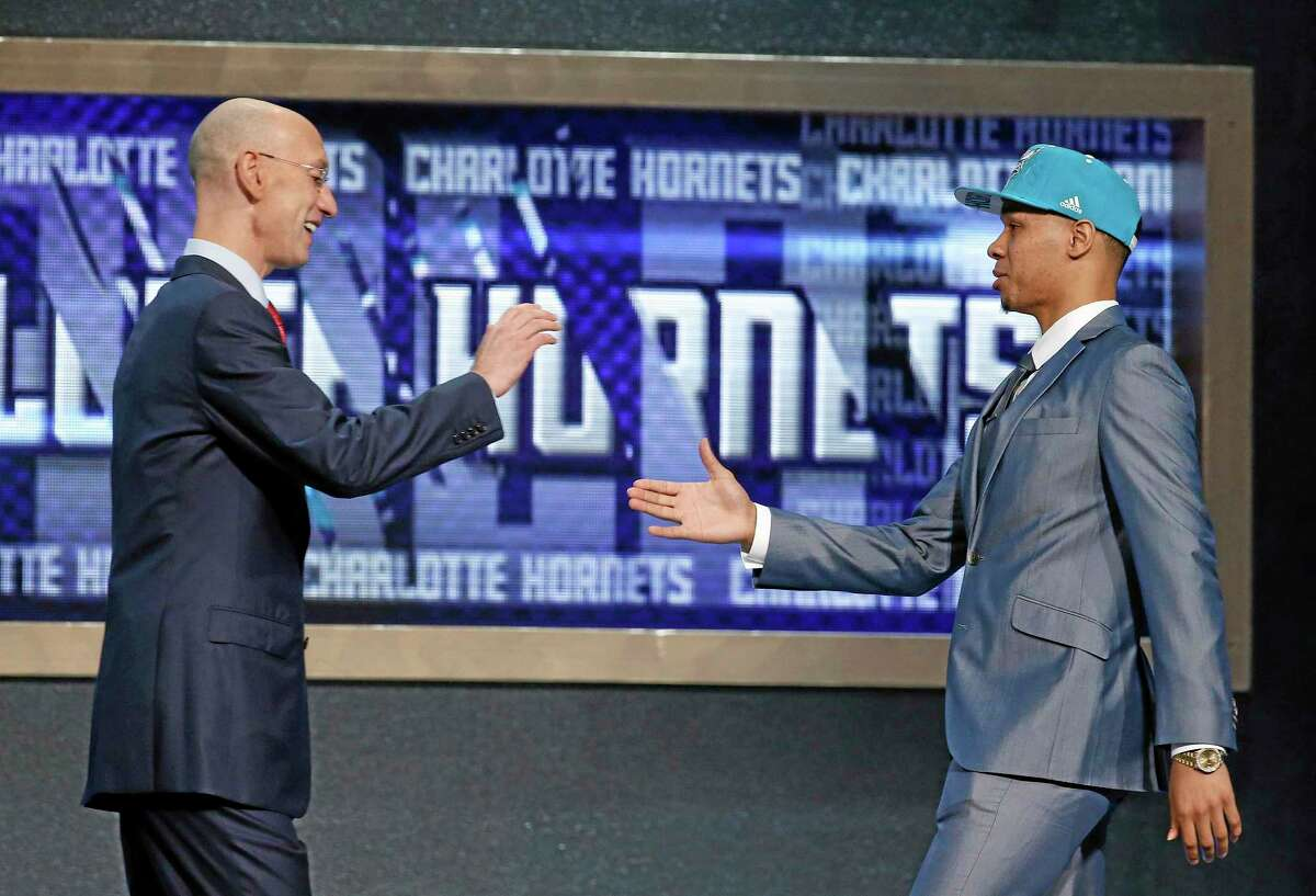 UConn's Shabazz Napier, right, is greeted by NBA Commissioner Adam Silver after being selected as the 24th overall pick in Thursday's NBA draft.