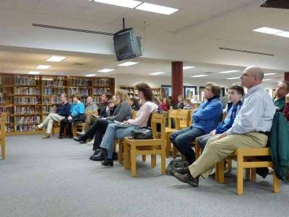 Photo by Ryan Flynn/The Register Citizen Residents sit at a public hearing on the Torrington Board of Education's proposed budget.