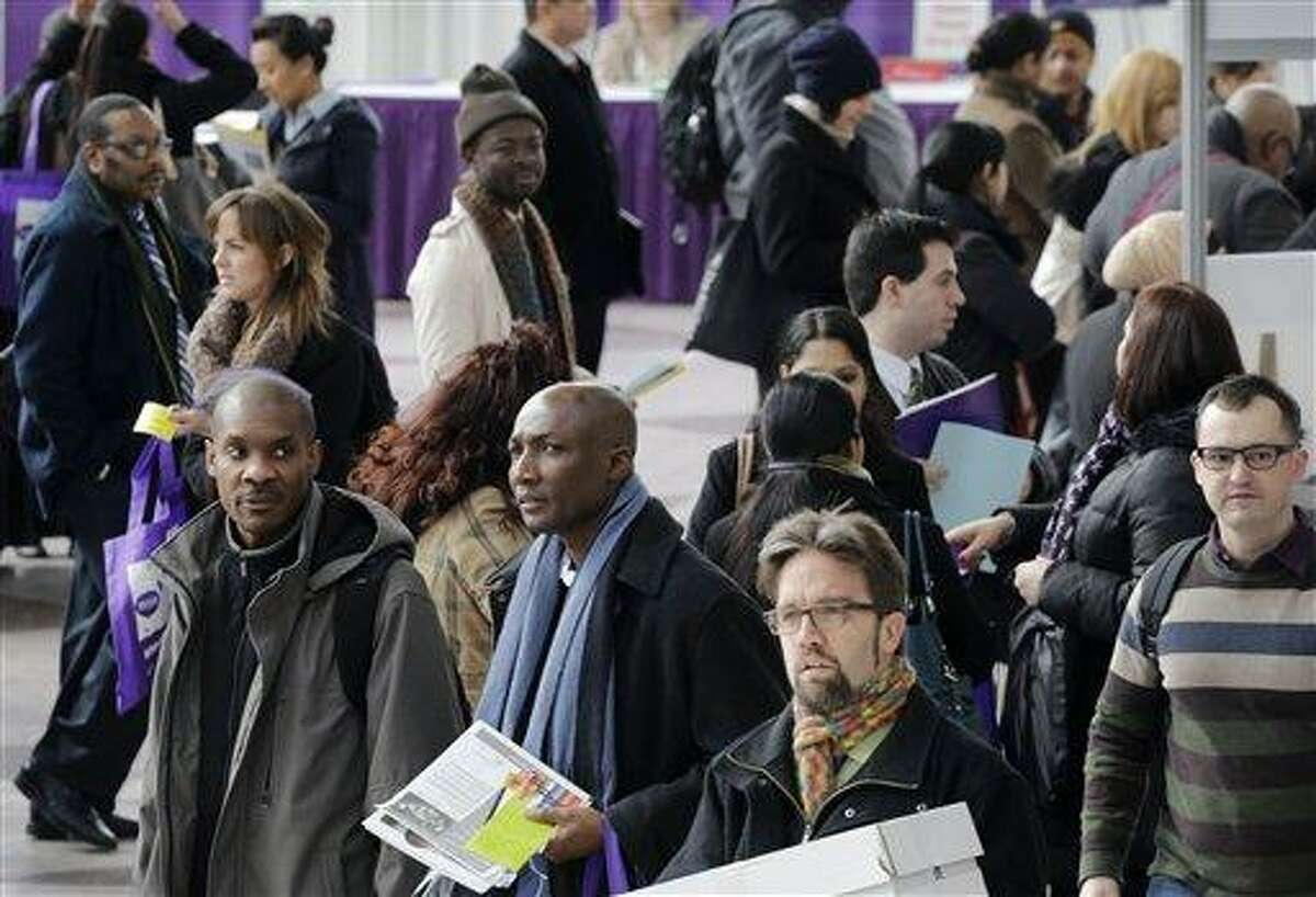 A crowd of job seekers attends a health care job fair, Thursday, March 14, 2013 in New York. Fewer Americans sought unemployment aid last week, reducing the average number of weekly applications last month to a five-year low. The drop shows that fewer layoffs are strengthening the job market. The Labor Department said Thursday that applications fell 10,000 to a seasonally adjusted 332,000. That cut the four-week average to 346,750, the lowest since the week of March 8, 2008, just several months after the Great Recession began. (AP Photo/Mark Lennihan)