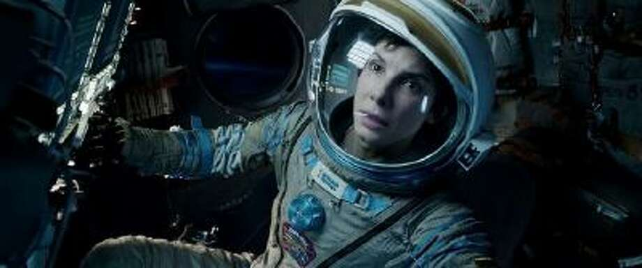 """This film image released by Warner Bros. Pictures shows Sandra Bullock in a scene from """"Gravity."""" Bullock says making the lost-in-space movie directed by Alfonso Cuaron was her """"best life decision"""" ever. (AP Photo/Warner Bros. Pictures) Photo: AP / Warner Bros. Pictures"""