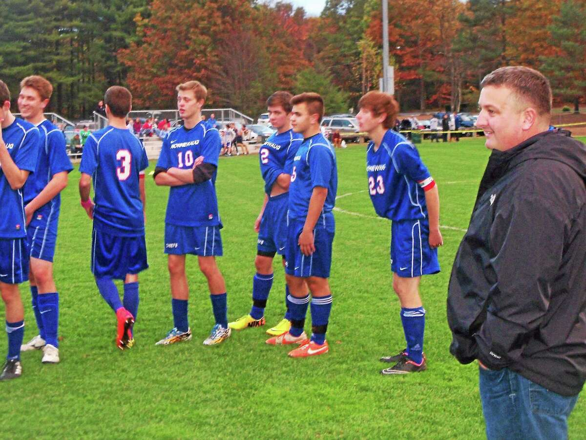 Nonnewaug coach Toby Denman oversees the Chiefs' pre-game shot line before a match against Lewis Mills Tuesday.