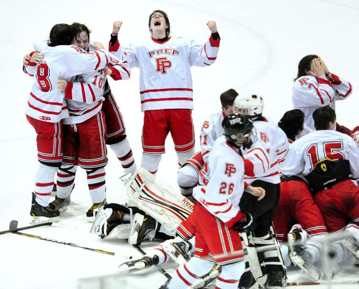 Michael Ventricelli (center) and his Fairfield Prep teammates celebrate their 3-2 victory over Notre Dame-West Haven in the CIAC State Hockey Championship at Ingalls Rink in New Haven on 3/19/2013.Photo by Arnold Gold/New Haven Register