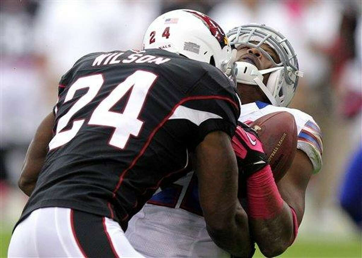 FILE - In this Oct. 14, 2012 file photo, Arizona Cardinals strong safety Adrian Wilson (24) levels Buffalo Bills running back Fred Jackson during the first half of an NFL football game in Glendale, Ariz. With Wilson at strong safety, the New England Patriots have a new physical presence in the secondary. The newly-signed Wilson, who spent the last 12 seasons with the Cardinals, signed with the Patriots as a free agent. (AP Photo/Paul Connors, File)