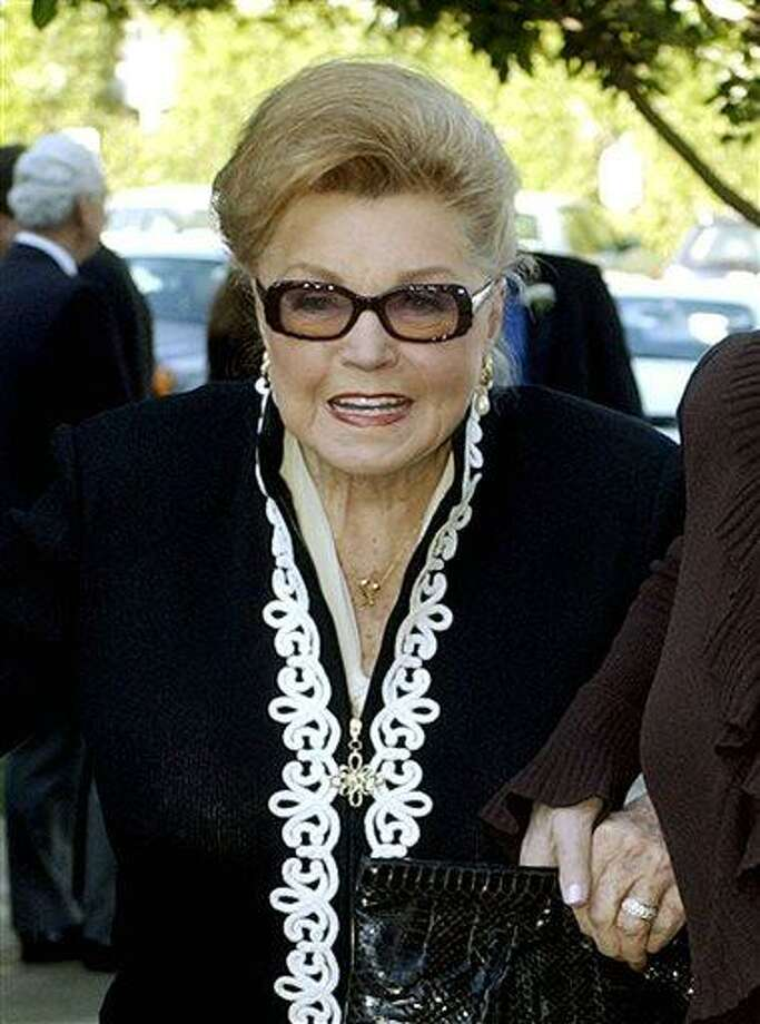 FILE - This Jan. 28, 2004 file photo shows Esther Williams at the funeral service for dancer/actress Ann Miller at St. Mel Catholic Church in Los Angeles' Woodland Hills area. According to a press representative, Williams died in her sleep on Thursday, June 6, 2013, in Beverly Hills, Calif.  She was 91. (AP Photo/Reed Saxon, file) Photo: AP / AP