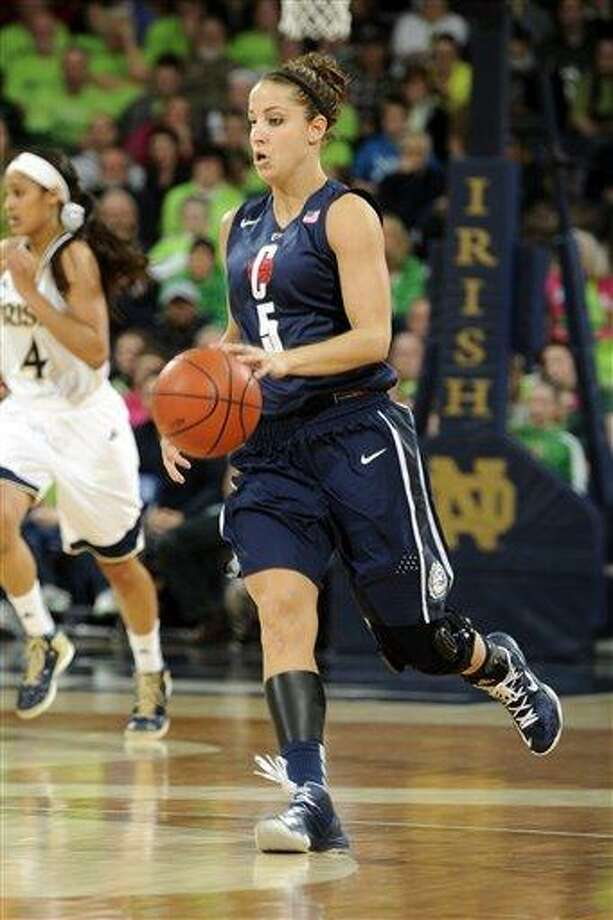 Connecticut guard Caroline Doty heads up court during action in a college basketball game Monday March 4, 2013 in South Bend, Ind. (AP Photo/Joe Raymond) Photo: ASSOCIATED PRESS / AP2013