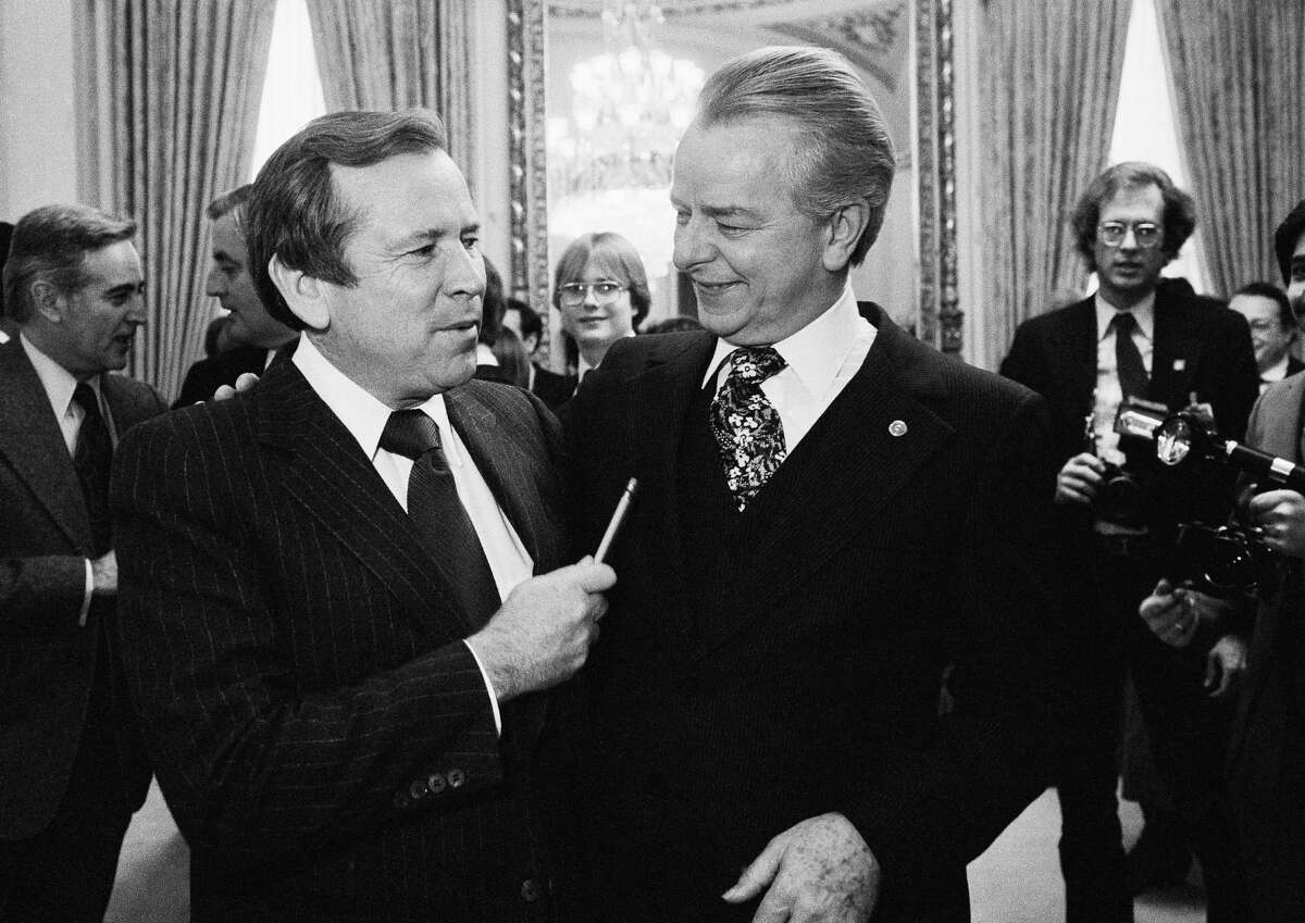 This Dec. 4, 1980, file photo shows Senate Majority Leader Robert Byrd of W.Va., right, talking to the man who will replace him, Sen. Howard Baker, R-Tenn., on Capitol Hill in Washington. Baker, who asked what President Richard Nixon knew about Watergate, has died. He was 88. Baker, a Republican, served 18 years in the Senate. He earned the respect of Republicans and Democrats alike and rose to the post of majority leader. He served as White House chief of staff at the end of the Reagan administration and was U.S. ambassador to Japan during President George W. Bush's first term.