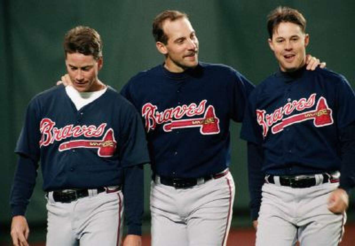Greg Maddux (right) along with Hall of Fame classmate Tom Glavine (left) and future Hall of Famer John Smoltz appear together in this 1993 photo.