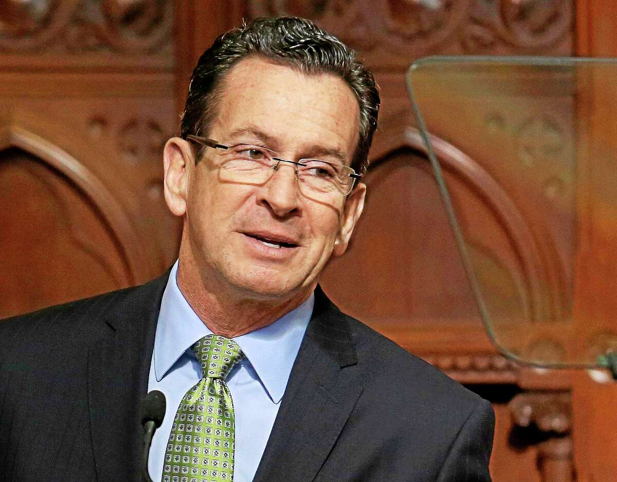 In this Feb. 6, 2014 photo, Connecticut Gov. Dannel P. Malloy delivers his 2014 State of the State address before a joint session of the legislature in the House Chambers at the Capitol in Hartford, Conn.