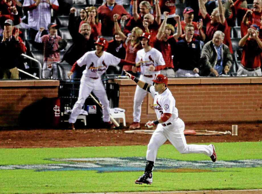 The Cardinals' Carlos Beltran celebrates after hitting his game-winning hit in the 13th inning of Game 1 of the National League championship series against the Los Angeles Dodgers. Photo: Chris Carlson  — The Associated Press  / AP