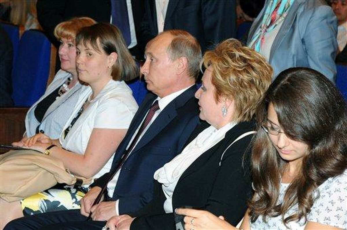 """Russian President Vladimir Putin, third right, and his wife Lyudmila, second right, attend the ballet """"La Esmeralda"""" in the Kremlin Palace in Moscow, Russia, Thursday, June 6, 2013. (AP Photo/RIA-Novosti, Mikhail Klimentyev, Presidential Press Service)"""
